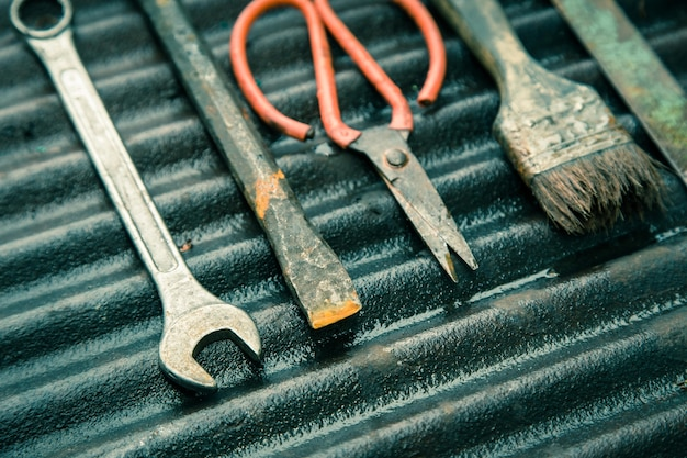 Mechanic tools set on dirty zinc background