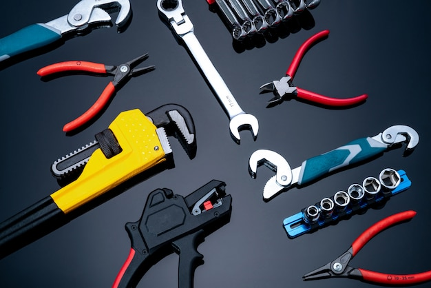 Mechanic tools. set of pipe wrench, bent wrench, nuts, spanner, pliers, and chrome combination wrenches. service technician tools for maintenance and fix work.