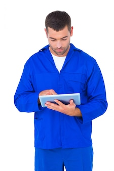 Mechanic using digital tablet on white background