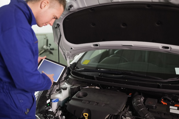 Mechanic using a tablet computer