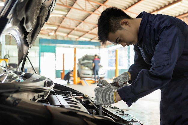 Mechanic using a wrench and screwdriver