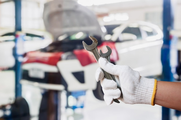 Mechanic with wrench in garage