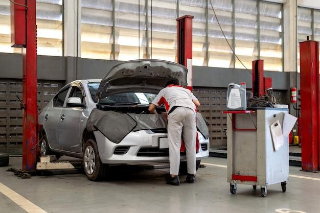 Mechanic working car maintenance