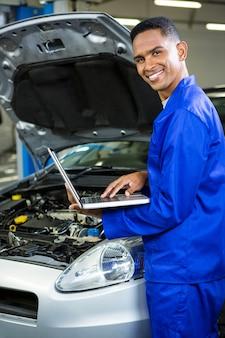 Mechanic working on laptop