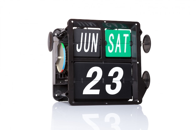 Mechanical calendar retro date 23 june, on isolated united nations public service day.