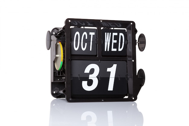 The mechanical calendar retro date 31 october, on isolated happy halloween.