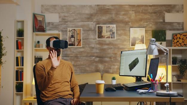 Mechanical engineer using virtual reality headset to design a turbine system.