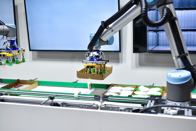 Mechanical robot with artificial intelligence sorts products on the conveyor