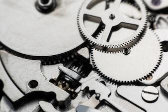 Mechanical watch / Gear Clock. Close up cogs and gears inside clock background