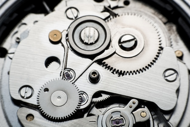 Mechanical watch / gear clock. close up cogs and gears inside clock background