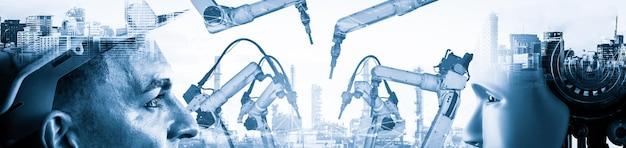 Робот механизированной промышленности и человек-рабочий работают вместе на заводе будущего Premium Фотографии
