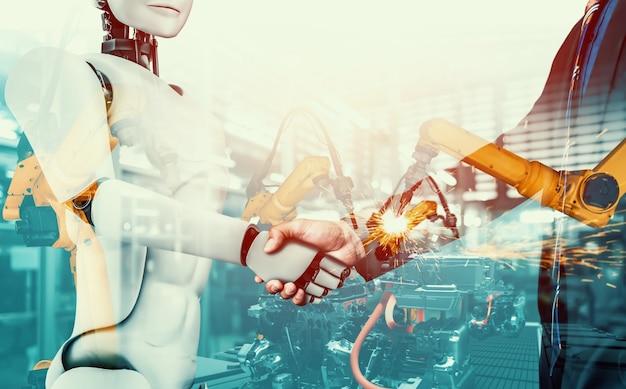 미래 공장에서 함께 일하는 기계화된 산업 로봇과 인간 노동자