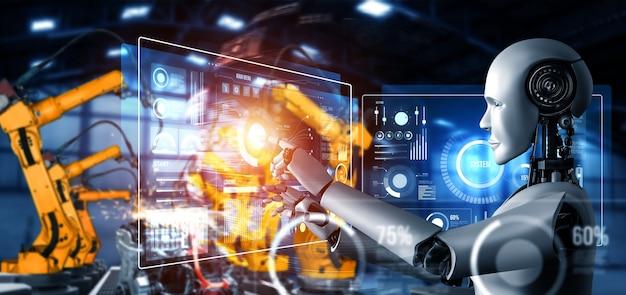 Робот механизированной промышленности и роботизированные манипуляторы для сборки в заводском производстве. Premium Фотографии