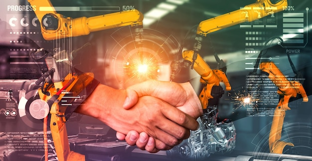 Mechanized industry robot arm and business handshake double exposure
