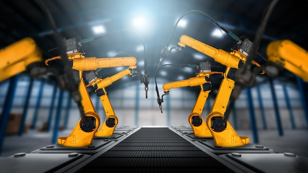 工場の生産ラインで組み立てるための機械化された産業用ロボットアーム