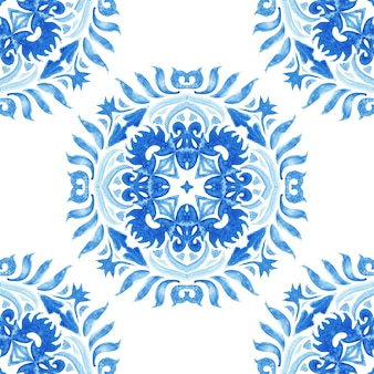 Medallion damask watercolor blue and white hand drawn tile seamless ornamental paint pattern. elegant luxury texture for fabric and azulejo tile