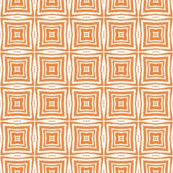 メダリオンシームレスパターン。オレンジ色の対称的な万華鏡の背景。テキスタイルレディフェッチプリント、水着生地、壁紙、ラッピング。水彩メダリオンシームレスタイル。