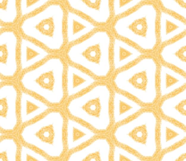 メダリオンシームレスパターン。黄色の対称的な万華鏡の背景。水彩メダリオンシームレスタイル。テキスタイルレディファンシープリント、水着生地、壁紙、ラッピング。