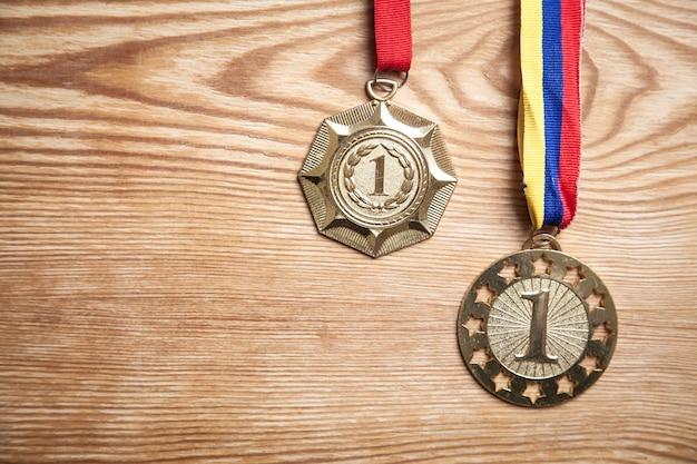 Medals awards for winner on wood background.