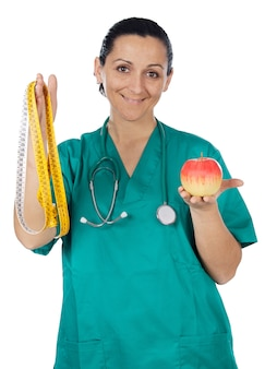 Medial staff with an apple and tape measure