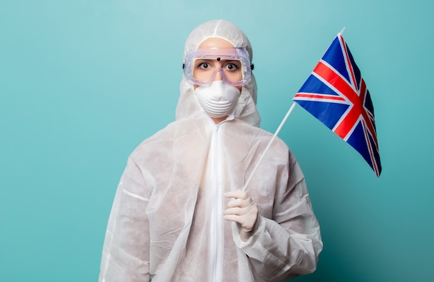 Medic woman wearing protective clothing against the virus with uk flag