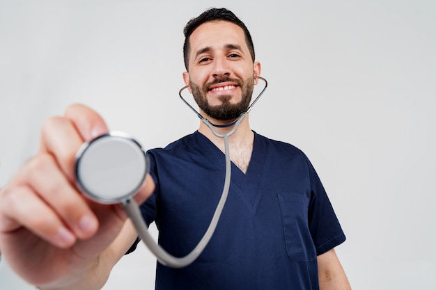 Medical arabian student does auscultation to patient.