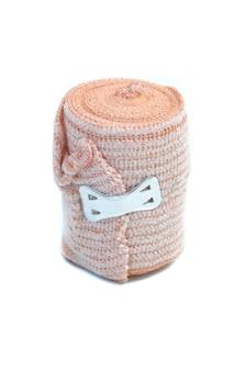 Medical bandage roll on white background