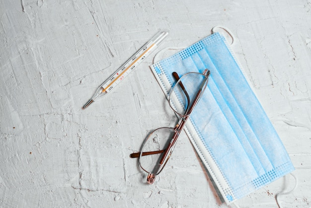 Medical blue masks and thermometer