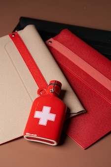 Medical concept  with folders and medical bottle. file folders and flask on pink