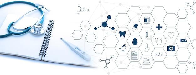 聴診器と白い背景の医療の白いアイコンと医療の概念