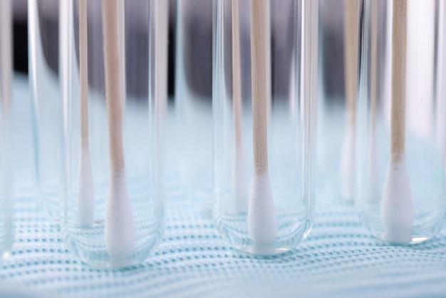 Medical cooton sticks in test tubes