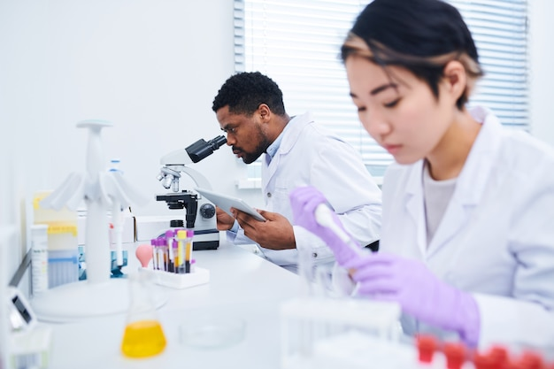 Medical diagnostic specialists analyzing substances