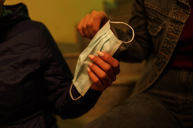Medical disposable mask in the hands of young girls