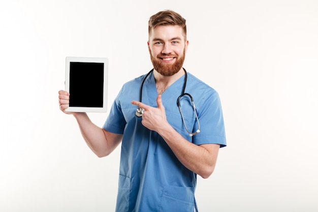 Medical doctor or nurse pointing finger at blank screen tablet