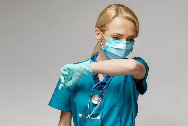 防護マスクとゴムやラテックスの手袋を着用して医師看護師女性-咳