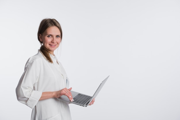 Medical doctor woman smile and holding tablet pc