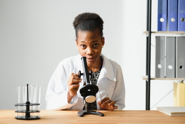 Medical doctor woman working at laboratory - copyspace