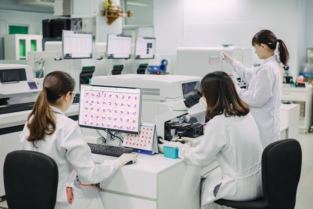 Medical doctor working for analyzing blood samples in laboratory of scientific research.