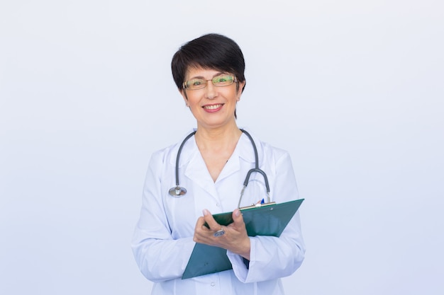 Medical doctor writing prescription over white background.