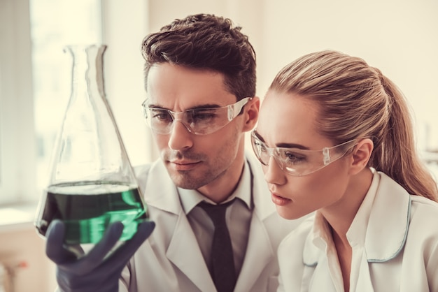 Medical doctors are studying essence in test tubes.