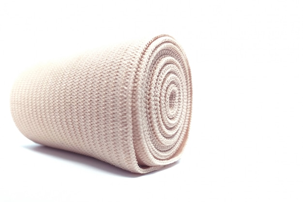 Medical elastic bandage roll for support first aid kit isolated on white.