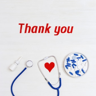 Medical elements on table with 'thank you' text