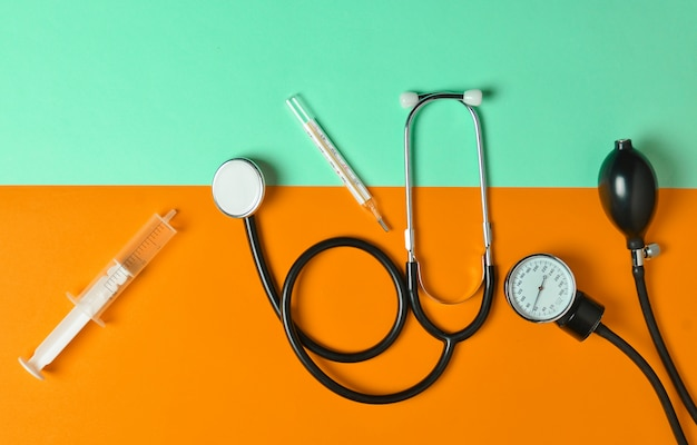 Medical equipment on a colored paper.