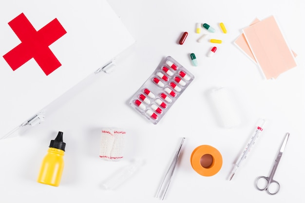 Medical equipments with first aid box on white background
