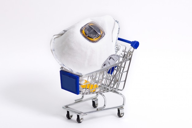 Medical face masks on trolley isolated on white. safe shopping. healthcare and medicine concept.