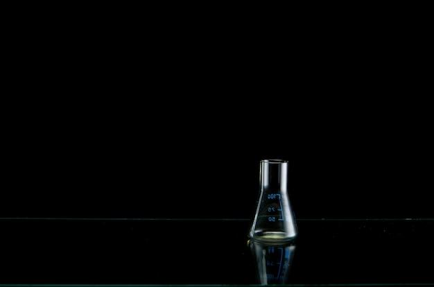 Medical flask on black