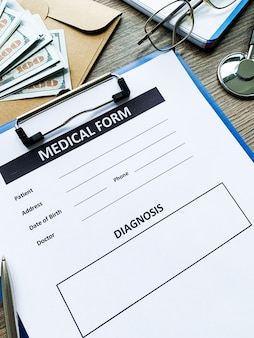 Medical form with patient data on doctor's desk.