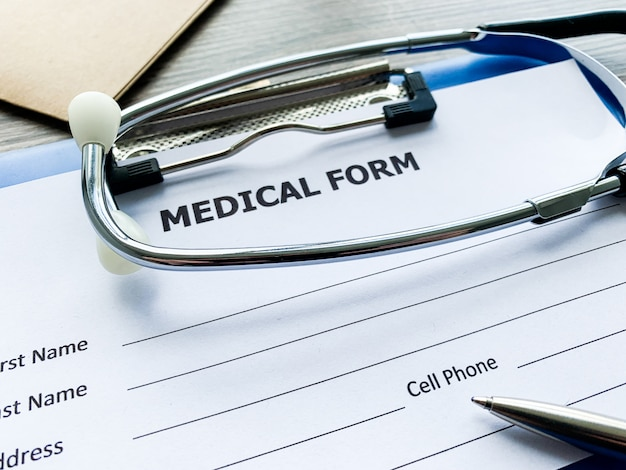 Medical form with patient data on doctor's desk