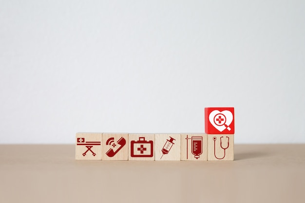 Medical and health icons on wood block .