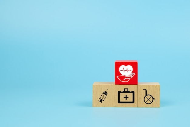Medical icon on cube wooden toy blocks stack in pyramid shape